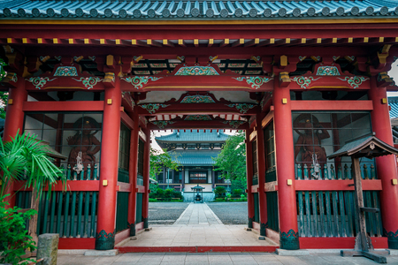 Traditional Japanese red wooden pagoda with colorful decorations, Tokyo, Japan