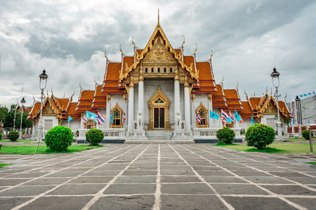 Moody shot of Wat Benchamabophit Temple from outside during overcast day, Bangkok, Thailand