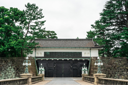 Entrance gate to the Edo Castle in the Imperial Palace complex with bridge in the foreground and fortified gate in background, Tokyo Japan