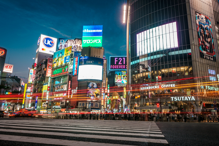 TOKYO, JAPAN - AUGUST 5, 2018: Long exposure of famous Shibuya street crossing with thousands of people and neon signs Editorial