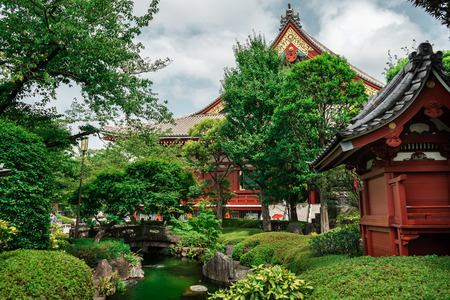 Gardens of Sensoji Temple with trees and river in foreground and traditional Japanese temple in background, Asakusa Temple, Tokyo, Japan Editorial