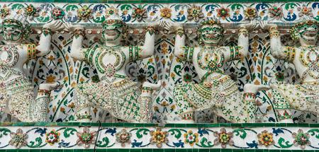 Closeup shot of historic colorful murals in Wat Arun temple depicting Thai warriors, Bangkok, Thailand