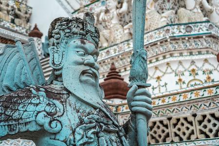 Closeup shot of stone warrior statue in Wat Arun temple, Bangkok, Thailand