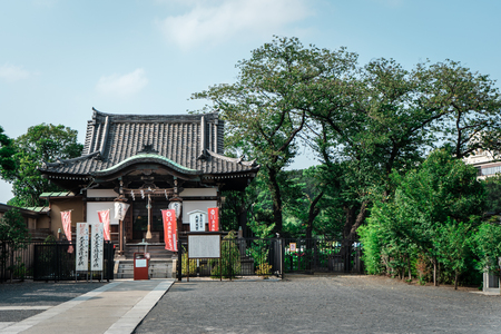 Traditional Japanese wooden pagoda temple surrounded by trees in Ueno Park, Tokyo, Japan Editorial