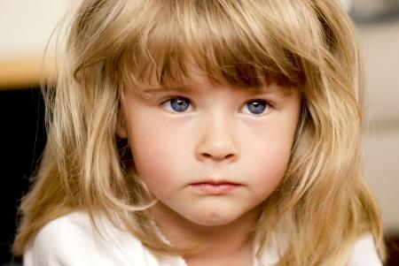 Little girl avoiding eye contact. Raising children concept. Stock Photo