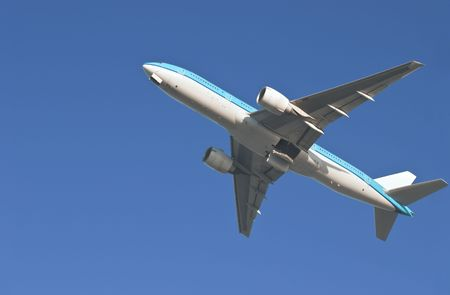 departing: Airplane departing with open wheel flaps Stock Photo