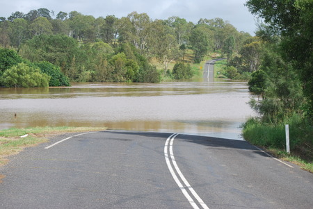flooded: Flooded Road in Queensland Stock Photo