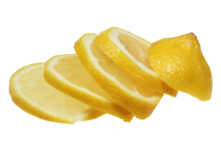 The lemon is sliced is isolated on a white background  Stock Photo