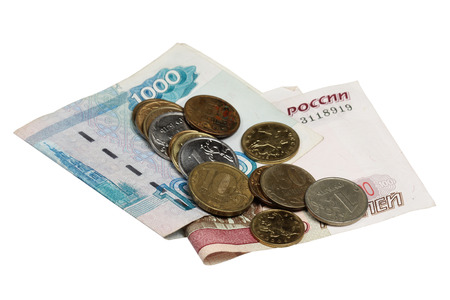 Notes hundred and thousands of rubles and a coin on a white background Stock Photo