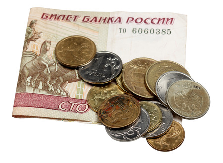 The note hundred rubles and coins are isolated on a white background Stock Photo