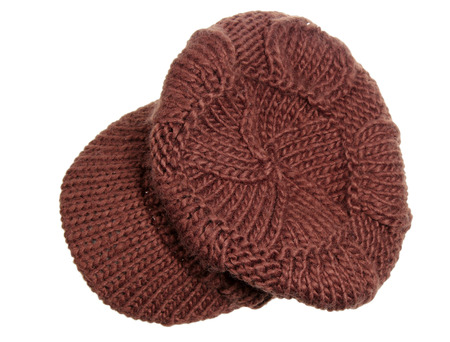 Womens brown knitted cap on a white background