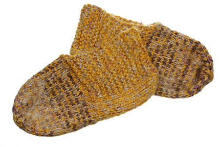 stocking feet: Woolen sock of handwork it is isolated on a white background