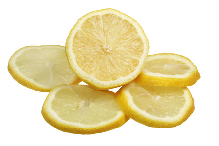 The lemon is sliced is isolated on a white background