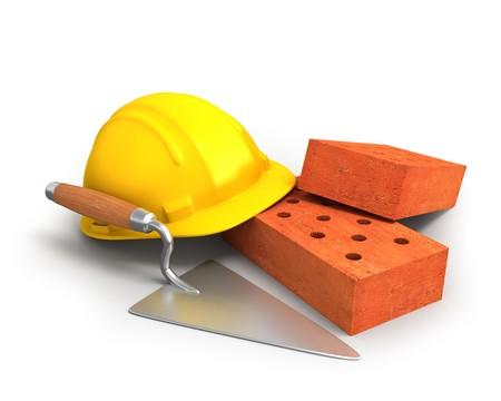 bricklayer: Ladrillos, paleta y un casco  Foto de archivo