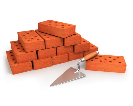 Trowel and stack of bricks isolated on white  photo