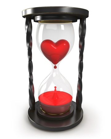 Hourglass with heart and blood photo