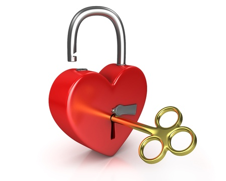 Opened red lock formed as heart with a golden key in a keyhole isolated on white background photo