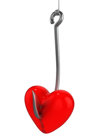 Red heart on a fishing hook isolated on white background photo