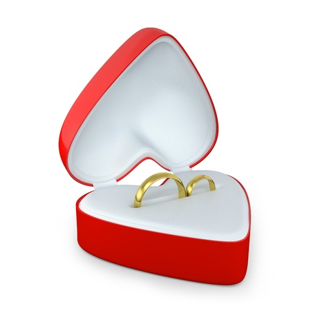 Pair of wedding rings in a heart shaped box isolated on white background photo