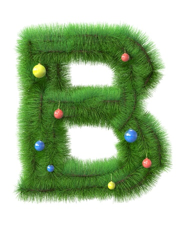 B letter made of christmas tree branches isolated on white background photo