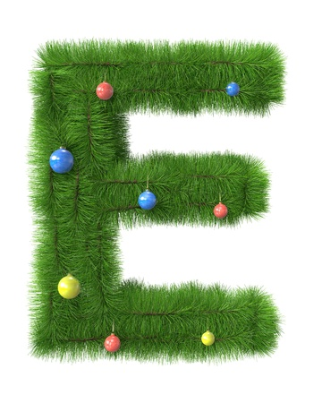 E letter made of christmas tree branches isolated on white background photo