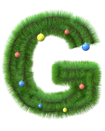 G letter made of christmas tree branches isolated on white background photo