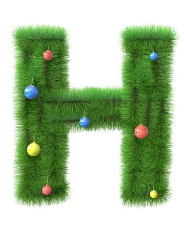 H letter made of christmas tree branches isolated on white background photo