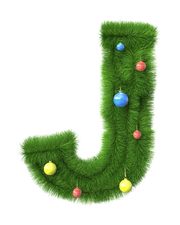 J letter made of christmas tree branches isolated on white background photo