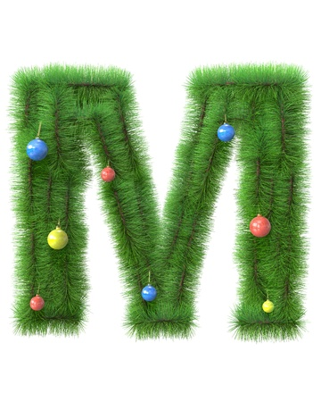 M letter made of christmas tree branches isolated on white background photo