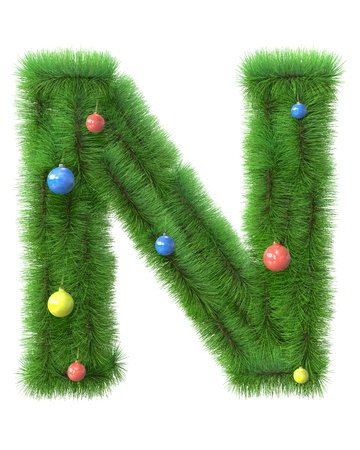 N letter made of christmas tree branches isolated on white background photo