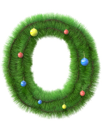 O letter made of christmas tree branches isolated on white background photo