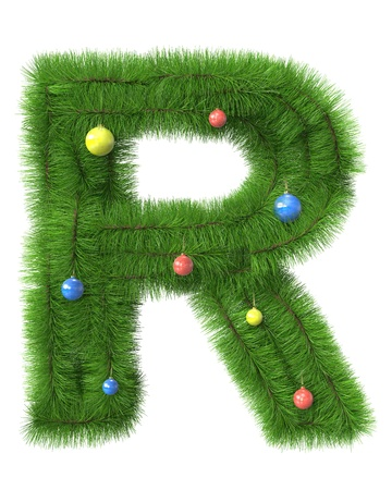 R letter made of christmas tree branches isolated on white background photo