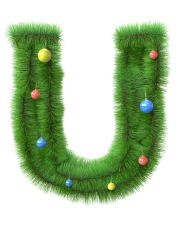 U letter made of christmas tree branches isolated on white background photo