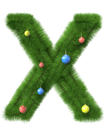X letter made of christmas tree branches isolated on white background photo