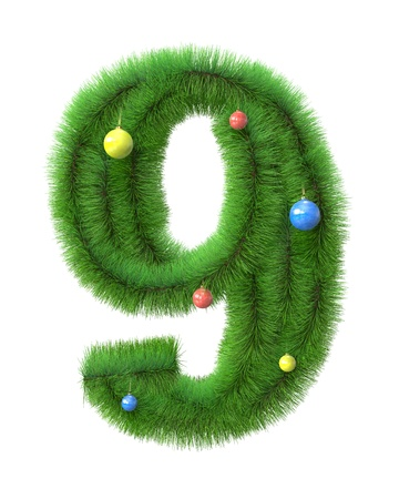 9  number made of christmas tree branches isolated on white background photo