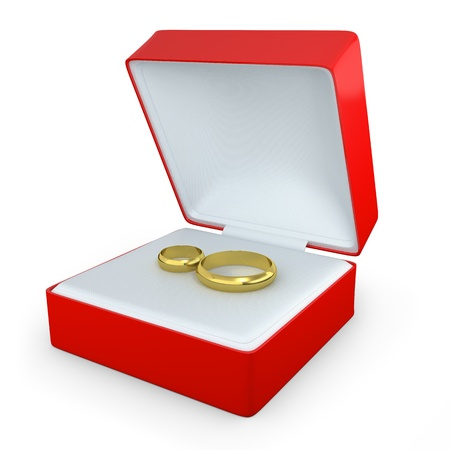 Pair of wedding rings in a rectangular shaped box isolated on white background photo