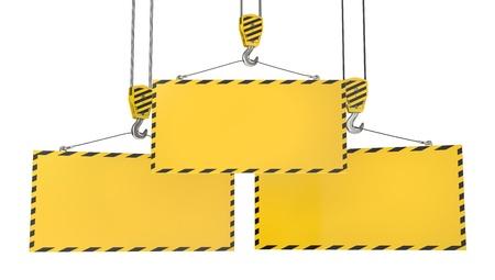 Three crane hooks with blank yellow plates, isolated on white background Stock Photo - 12304399