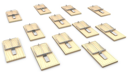 A lot of mouse traps isolated on white background photo