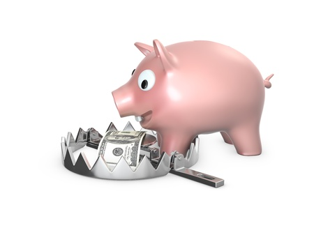 Piggy bank in a bear trap, isolated on white background photo