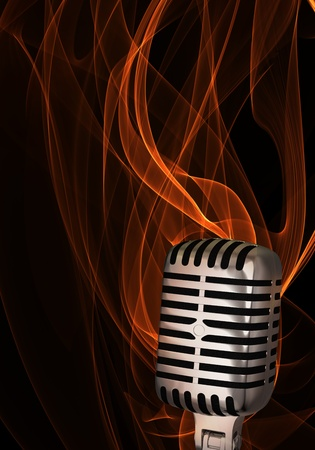 Shiny classic microphone on abstract flame background photo