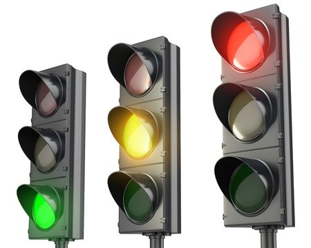 Three traffic lights, red green and yellow, isolated on white background photo