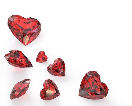 Few heart cut rubies, isolated on white background photo