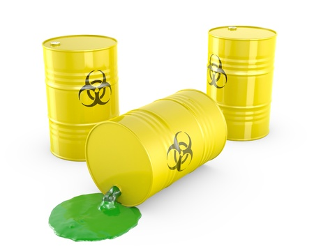 Toxic waste spilling from barrel, isolated on white background photo