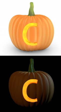 carved pumpkin: C letter carved on pumpkin jack lantern isolated on and white background