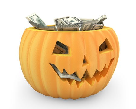 Holiday pumpkin jack lantern full of dollars isolated on white background photo