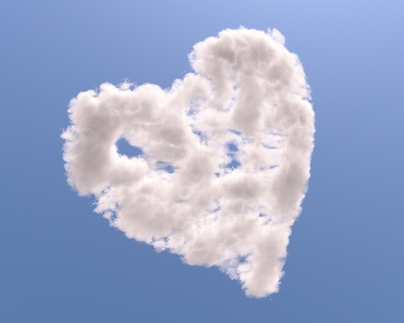 Heart shaped cloud, isolated on blue background photo