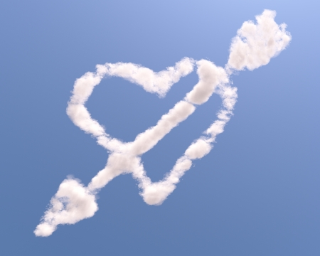 Heart shaped cloud with arrow, isolated on blue background photo