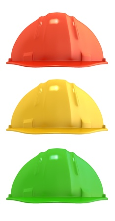 Three construction helmets colored as traffic light, isolated on white background photo