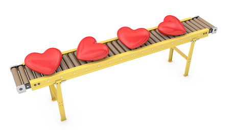 Read hearts on roller conveyor isolated on white background
