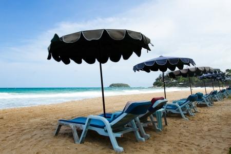 chairs & umbrellas on the beach at Phuket, Thailand photo